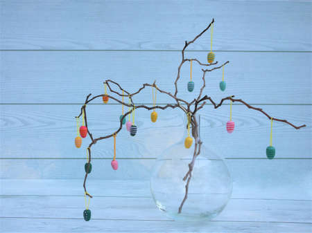Easter dekorative eggs on tree branches. Easter tree in vase with colorful eggs