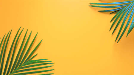 Green tropical palm leaves on bright yellow background. Minimal summer concept. Creative flat lay. Tropical palm leaves on yellow background. Minimal nature. Summer Styled. Flat lay. Top view. Space for text. 版權商用圖片