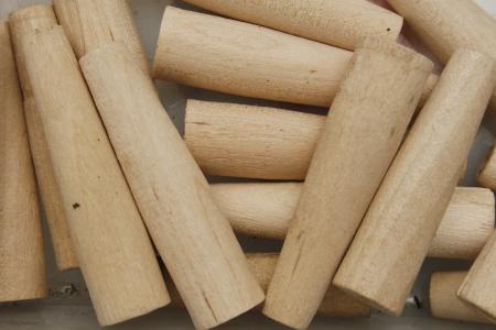 venting: close up image of wooden spiles for venting cask ale barrels