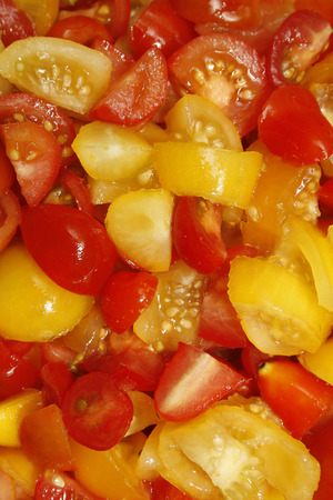 moneymaker: image of chopped tomatoes in glass bowl