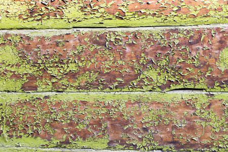 the natural phenomena: Old wooden house wall with cracked by time and natural phenomena green paint.