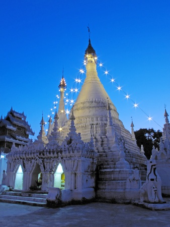 Pagoda in Thailand and Evening light photo
