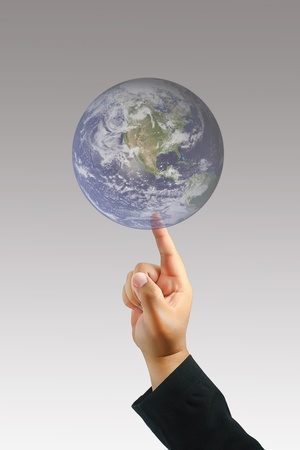 Men hand touch earth photo