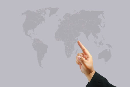 Business hand touch world map photo