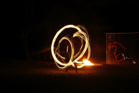 Fire staff swing Stock Photo - 12904117