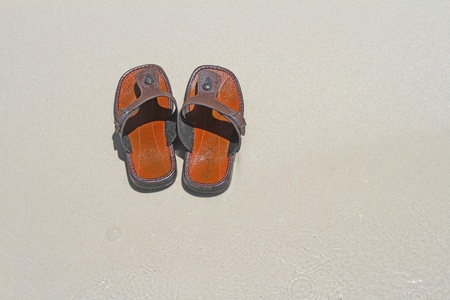 sandles: shoe on the beach