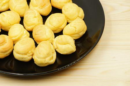 puffs: Close up Fresh Mini Cream Puffs on dish Stock Photo