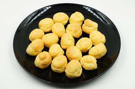 creampuff: Close up Fresh Mini Cream Puffs on dish Stock Photo