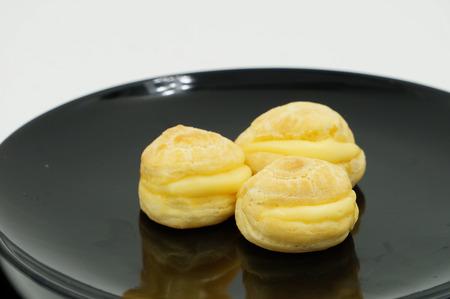 puffs: Close up Fresh Mini Cream puffs on dish