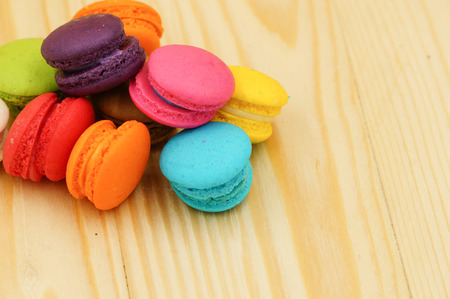 pink vintage background: Sweet and Tasty colourful french Macarons on wood texture background
