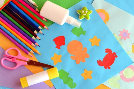 Paper sea animals and flowers crafts. A set of materials and tools for kids art. Easy way to realize kids imagination. Development of creative abilities in preschool children, primary school children Stock Photo