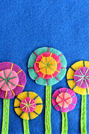 embellishments: Beautiful colorful flowers made of felt circles. DIY flowers embellishments. Festive background. Greeting card for birthday, Valentines day, Easter, mothers day Stock Photo