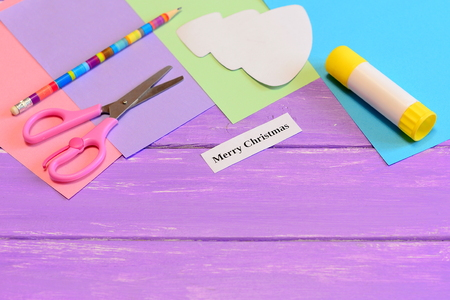 How to make paper greeting card Merry Christmas. Step. Colored paper set, scissors, pencil, Christmas tree template, glue stick. Materials and tools to create a Christmas card. Easy winter kids crafts