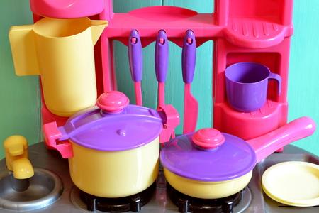 Set of kids dishes. Childrens toys. Childrens kitchen game. Kitchen utensils Stock Photo