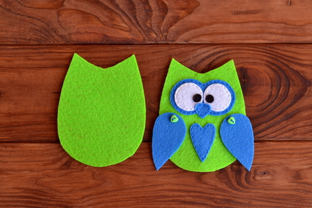 needlecraft: Soft felt toy pattern. Children sewing tutorial. Needlecraft sewing felt pattern. Felt body of a fabric owl. Stitched details toy. Easy crafts for kids