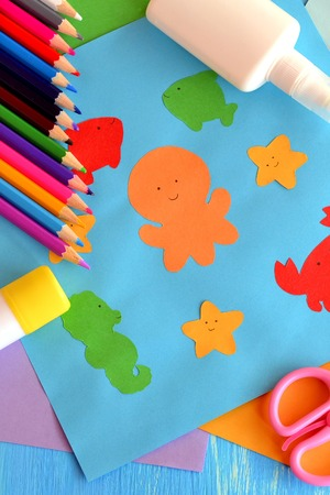 early childhood education: Preschool sea animals arts and crafts. Paper ocean animals. Children application from color paper make in kindergarten. Early childhood education. Pencils, glue, scissors. Kids background Stock Photo