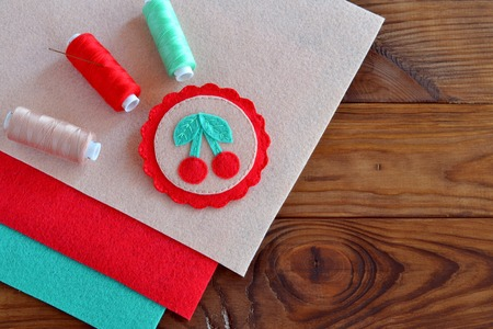 Beautiful felt applique brooch, beige, red and green felt sheets, thread, needle. Hand stitched brooch with berries and leaves. Summer art sewing