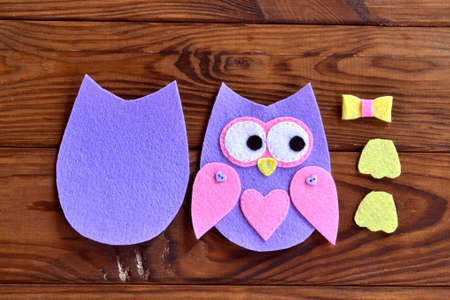 Torso, wings, legs, parts of the felt owls. Set for sewing on a brown wooden background. Fabric owl sewing. Sewing lesson. Sewing projects for the home handmade gifts craft ideas. DIY sewing projects