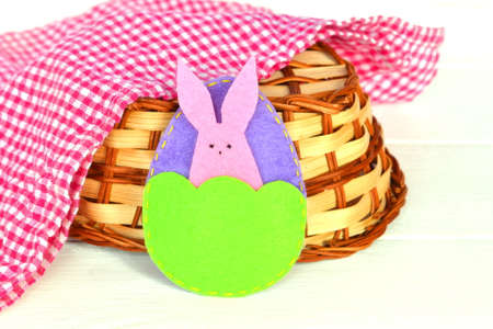 Easter egg and Bunny, basket, towel on white wooden background. Felt crafts. Easter crafts diy homemade creative. Homemade Easter crafts for kids easy diy. Felt Easter crafts projects 版權商用圖片