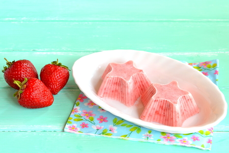 flavorful: Home pink ice cream shaped star, fresh strawberries. Strawberries mixed with yogurt and sugar and frozen in a freezer. Sweet berry sorbet on a plate Stock Photo