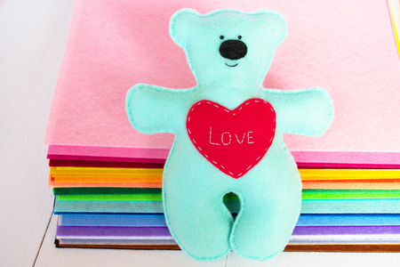 Blue felt bear toy with red heart Stock Photo