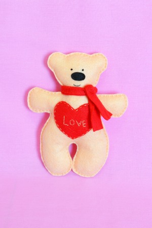 Cute felt bear toy with heart and word love. Valentines day gift