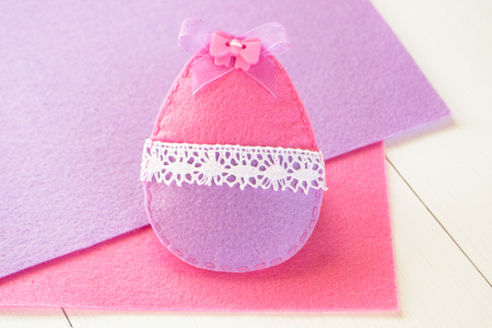 needle laces: Felt Easter egg - handmade toy Stock Photo