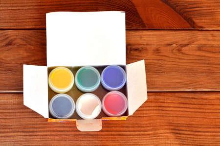 Children paint, gouache. Wooden background