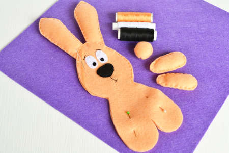 Sewing set for felt rabbit. How to make handmade toy. Step by step. DIY Easter rabbit crafts. Sewing by hand for beginners learning. DIY stuffed Easter bunny sewing projects