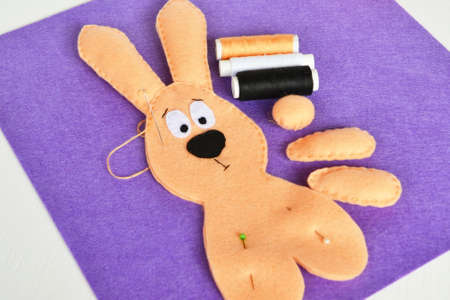 Sewing set for felt rabbit. How to make handmade toy. Step by step. DIY Easter bunny crafts. Hand sewing for beginners learning teaching kids. DIY Easter bunny crafts kids can make