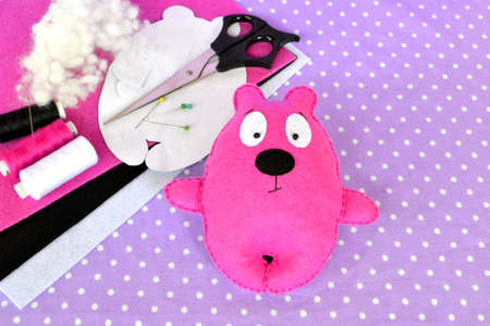 Pink felt Teddy bear, handmade felted toy. Scissors, needle, thread, pins, paper templates - sewing kit. Sewing activities for kids motor skills. Hand sewing photography. Handicrafts for kids