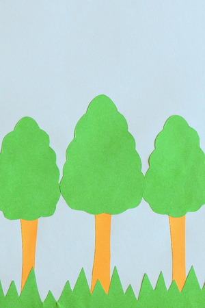 Paper trees applique with empty space for text. Earth day card. Childrens application of colored paper on Earth day Stock Photo