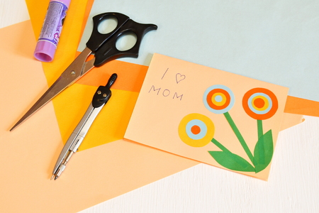 scissors: Mothers day card - how to make handmade crafts Stock Photo