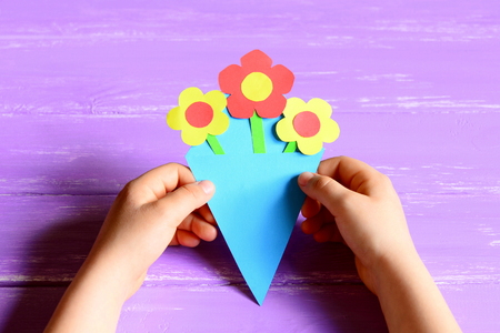 Small child made paper flowers for mothers day or birthday stock small child made paper flowers for mothers day or birthday child holds and shows mightylinksfo