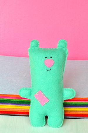 Cute green felt Teddy bear - handmade children toy Stock Photo