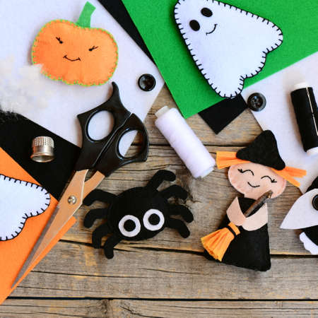 Sewing Halloween ghost decor. Join the felt edges of the toy using a blanket stitch and stuff with hollowfiber. Step. Instruction for children. Autumn festive diy idea. Closeup. Top view