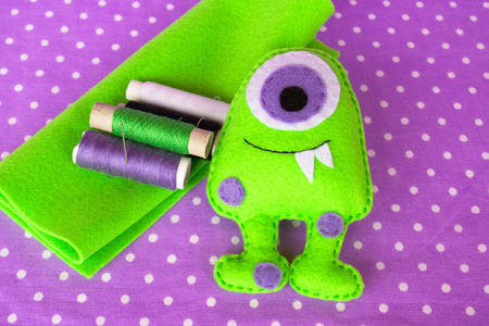 Sewing felt monster - how to make a monster handmade toy Stock Photo