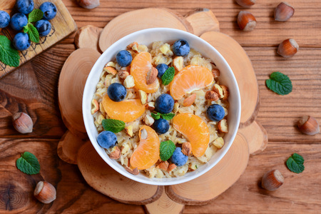 Easy oatmeal with citrus, berries and nuts.
