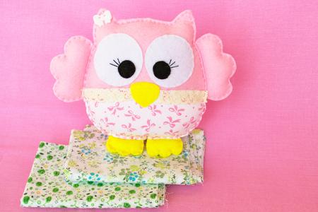 Pink felt owl - handmade childrens toy Stock Photo