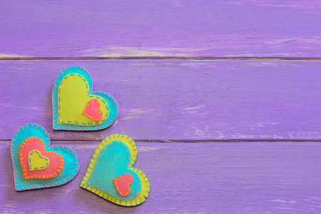 Felt hearts set. Valentine background with felt felt on wood. Happy Valentines day card. Wooden background with copy space Stock Photo
