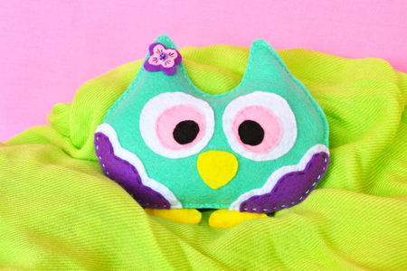 Felt owl - handmade felt colorful owl on pink and green background