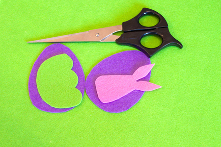 Felt Easter egg and bunny ornament. How to make handmade Easter ornament. Sewing craft concept. Kids Easter sewing