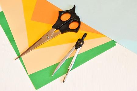 Set for creativity - colored paper, scissors, compasses Stock Photo