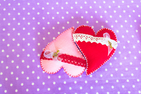 Red hair hearts on purple background. DIY Felt heart craft idea. Sewing. Valentines day crafts