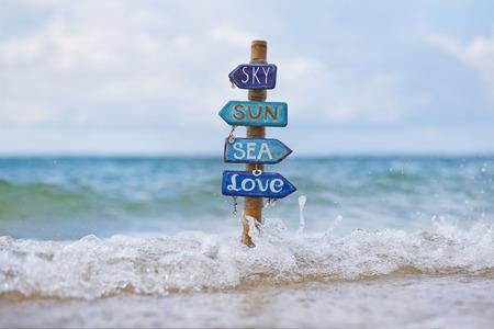 wooden handmade: Wooden handmade signpost on the beach
