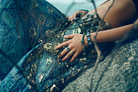 costume jewelry: Tribal style girl on the stone rocks. Koh Phangan, Thailand Stock Photo