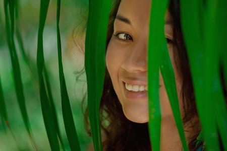Portrait of beautiful asian girl in green leaves