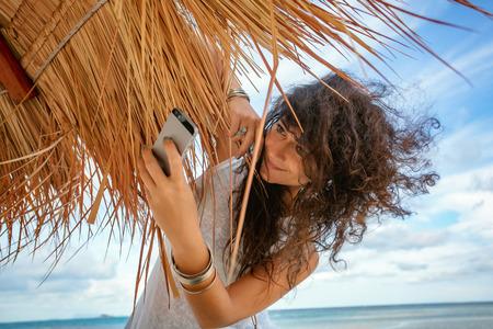 beautiful young woman having fun at beach