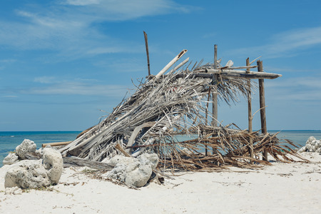 fisherman hut made of bamboo leaves on the beach