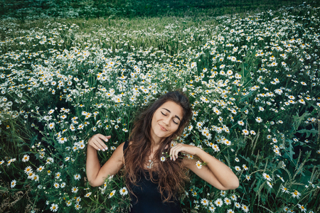 happy young woman on a field. healthy lifestyle concept